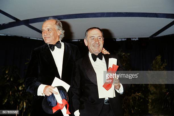 Spanish actors Alfredo Landa and Francisco Rabal pose with their trophy after they were awarded the Best actor prize during the closing ceremony of...