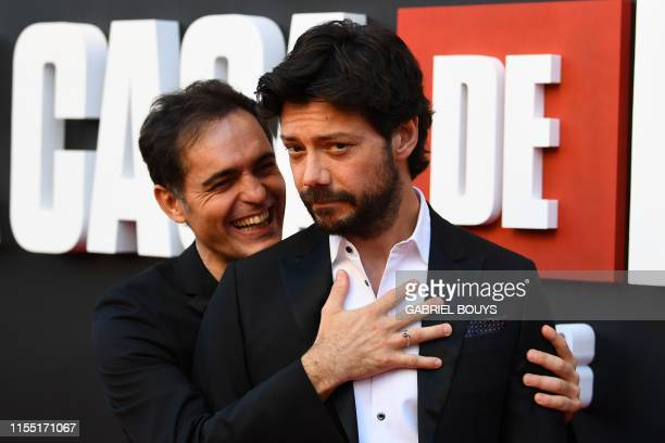 Spanish actors Alvaro Morte and Pedro Alonso pose during a photocall for the presentation of the third season of the Spanish TV show La Casa de Papel...