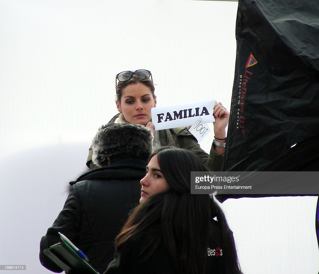 Spanish actress Amaia Salamanca is seen during a photo session for a photographer who is trying to reach a Guiness Record shooting people kissing to fight against the financial crisis on December 12, 2012 in Madrid, Spain.