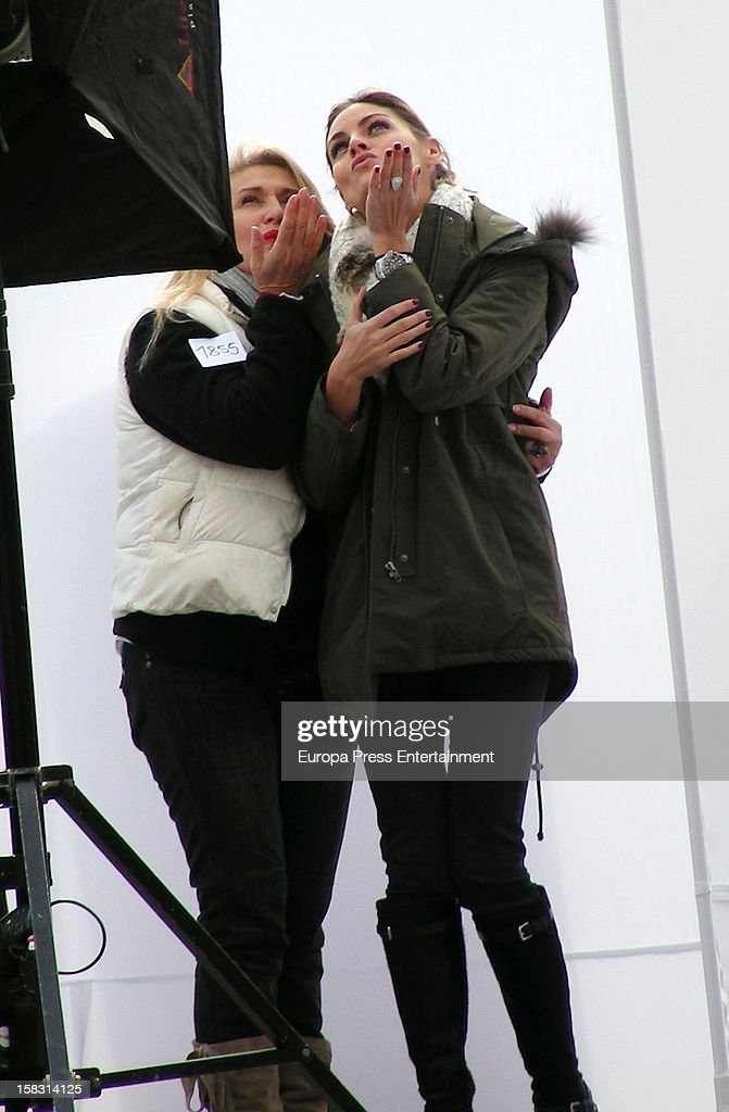 Spanish actress Amaia Salamanca (R) is seen during a photo session for a photographer who is trying to reach a Guiness Record shooting people kissing to fight against the financial crisis on December 12, 2012 in Madrid, Spain.
