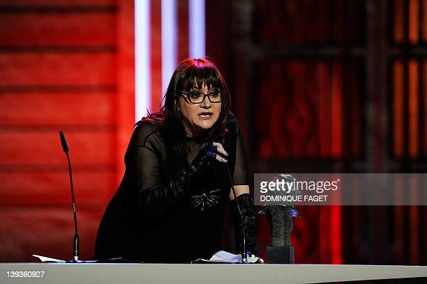 Spanish actress and director Isabel Coixet speaks to the audience after receiving a Goya award for best documentary film for her film Escuchando al...