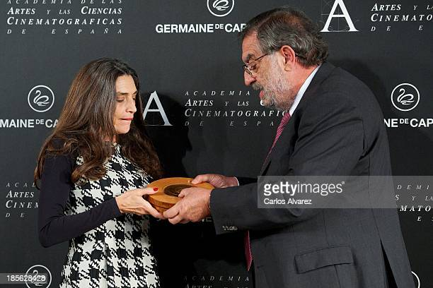 Spanish actress Angela Molina receives from President of Spanish Cinema Academy Enrique Gonzalez Macho the Goya Golden Medal 2013 at the Spanish...