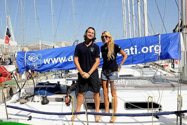 Spanish actress Carolina Cerezuela and her boyfriend Carlos Moya pose on board of Alex Rumbo a Ti during 28th Copa del Rey Audi Sailing Cup on August...