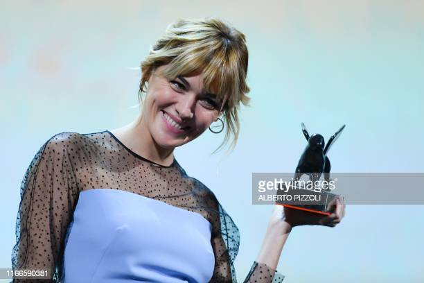 Spanish actress Marta Nieto holds the Orizzonti Award for Best Actress she received for the film Madre during the awards ceremony of the 76th Venice...