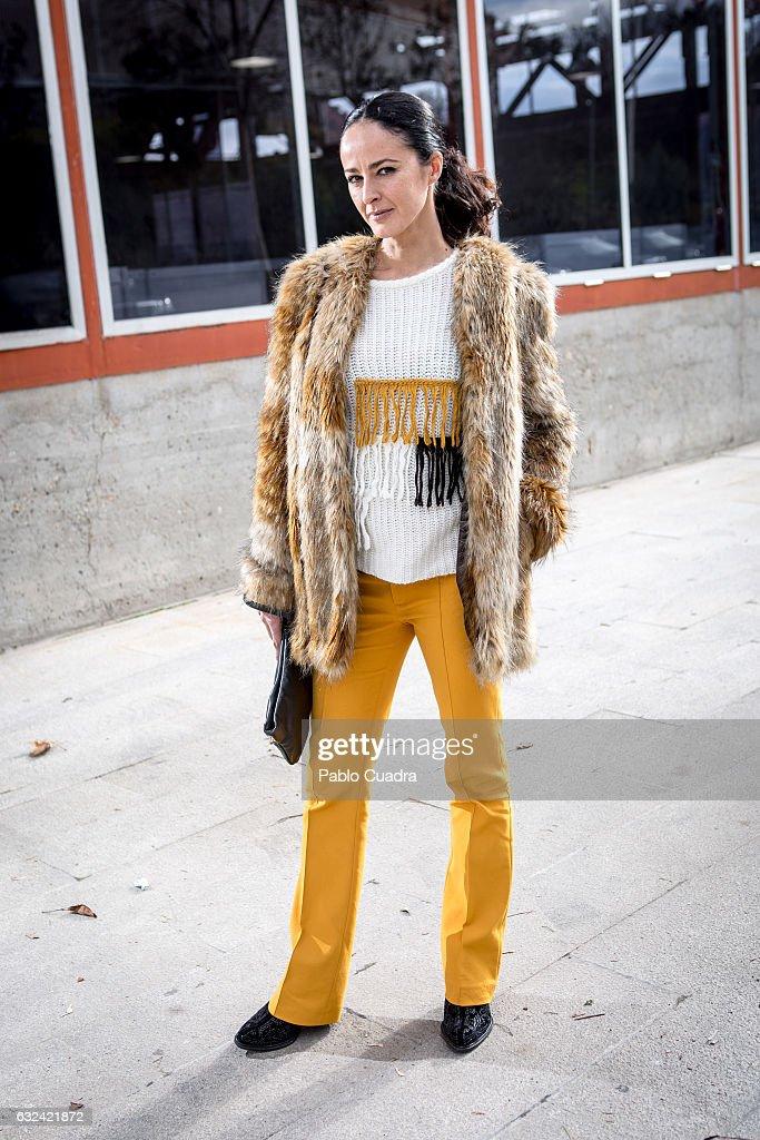 Spanish actress Monica Estarreado wears Monica Cordero trousers and pullover, Farrutx handbag, and Top Shop coat on January 22, 2017 in Madrid, Spain.