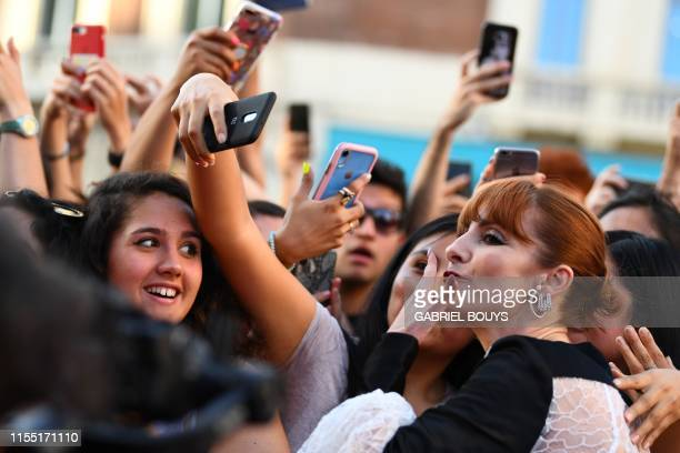 Spanish actress Najwa Nimri blows a kiss as she poses with fans during a photocall for the presentation of the third season of the Spanish TV show La...