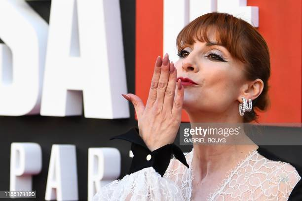 Spanish actress Najwa Nimri blows a kiss during a photocall for the presentation of Spanish TV show La Casa de Papel 3rd season on July 11 2019 in...