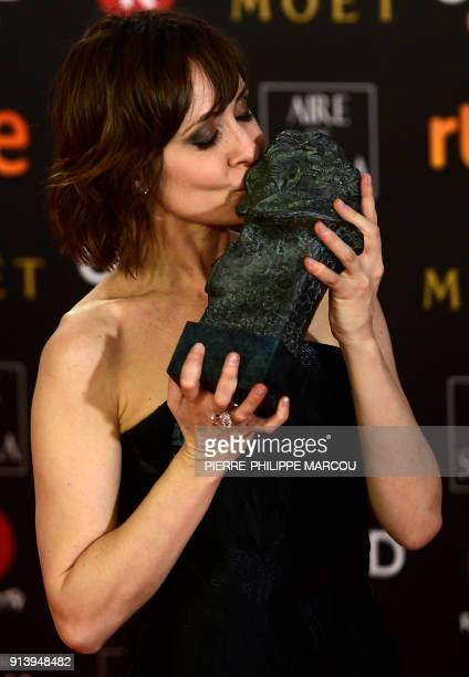 Spanish actress Nathalie Poza poses with the best actress award for her role in 'No se decir adios' at the 32nd Goya awards ceremony in Madrid on...