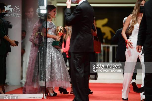 """Spanish actress Penelope Cruz holds the Coppa Volpi she received for Best Actress in """"Madres Paralelas"""" as she arrives to attend the Winners'..."""