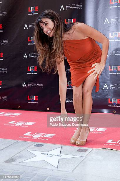 Spanish actress Penelope Cruz poses for photographers with her star during the opening of the Walk of Fame on June 27 2011 in Madrid Spain