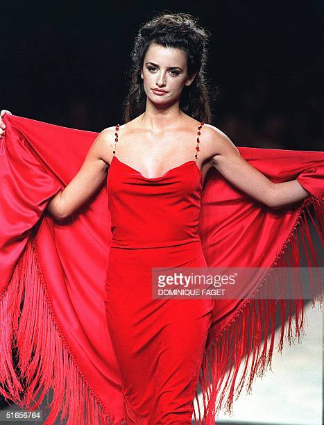 Spanish actress Penelope Cruz shows off 12 February an evening dress during the presentation of the Fall/Winter Victorio and Lucchino fashion show of...
