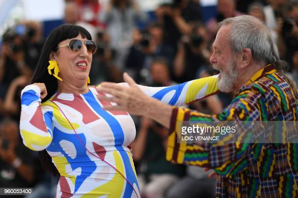 Spanish actress Rossy de Palma is greeted by BritishUS director Terry Gilliam as she arrives on May 19 2018 for a photocall for the film 'The Man Who...