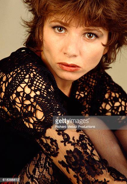 Spanish actress Victoria Abril poses in Paris in 1992