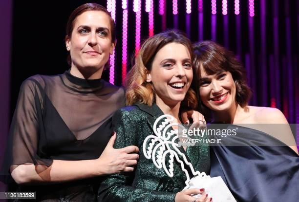 Spanish actresses Aixa Villagran, Leticia Dolera and Celia Freijeiro celebrate on stage after receiving the trophy for best series award for the...