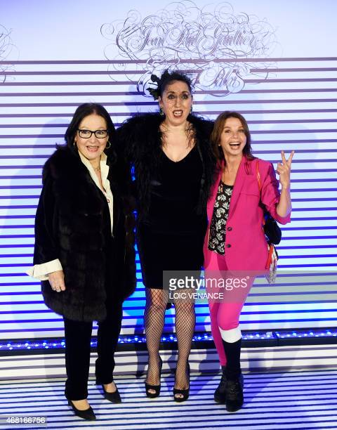 Spanish actresses Rossy de Palma and Victoria Abril pose with Greek singer Nana Mouskouri as they arrive to attend a party to celebrate the French...