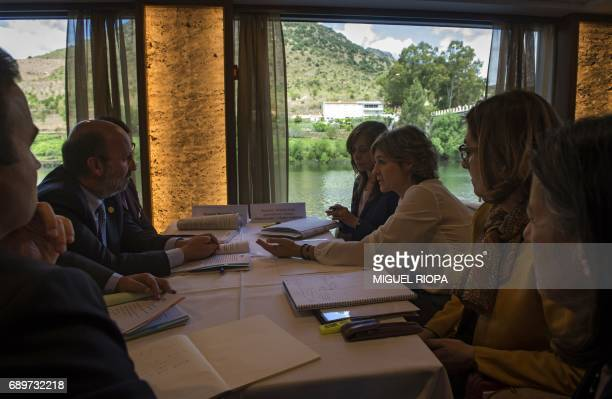 Spanish Agriculture Minister Isabel Garcia Tejerina speaks with her Portuguese counterpart Joao Matos Fernandes during a meeting onboard the 'MS...