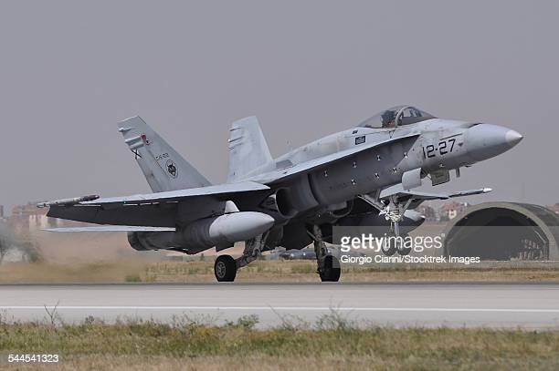 a spanish air force ef-18a aircraft landing at konya air base, turkey. - asian hornet stock pictures, royalty-free photos & images