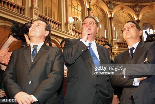 Spanish airline Iberia president Xabier de Irala stands next to the president of State Industrial holding company Pedro Ferreras and an unidentified...