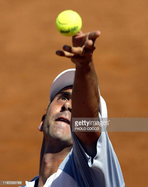 Spanish Alberto Costa serves the ball to Croatian Zeljko Krajan during the first round of the tennis Rome Masters Series 05 May 2003 at the Foro...