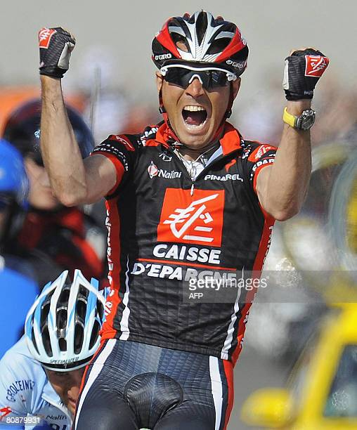 Spanish Alejandro Valverde celebrates as he crosses the finish line of the 94th LiegeBastogneLiege cycling race between Liege and Ans on April 27...