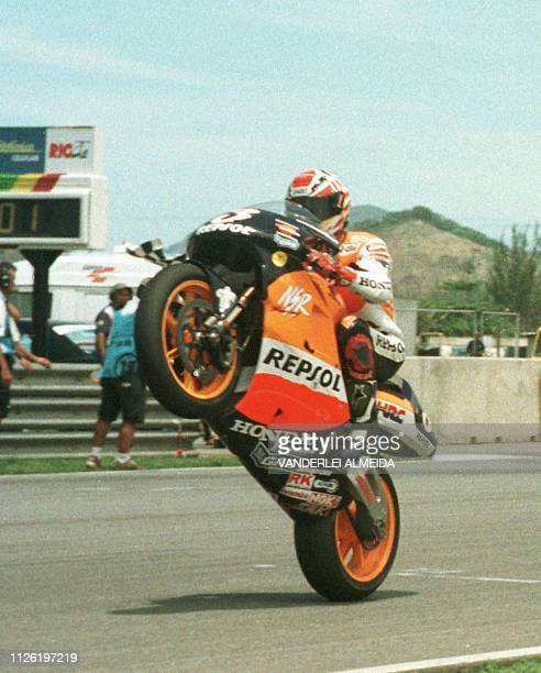 Spanish Alex Criville of team HondaRepsol celebrates his victory as world 500cc champion 24 October 1999 at the Brazilian Grand Prix in Rio de Janeiro