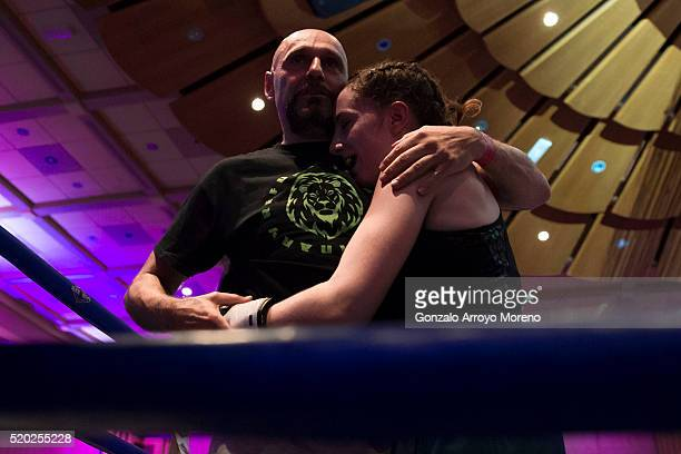 Spanish amateur champion Cristina Gomez hugs her coach Antonio Gonzalez Matias after winning a 4x2 bout against Vanesa Caruso the night of her...