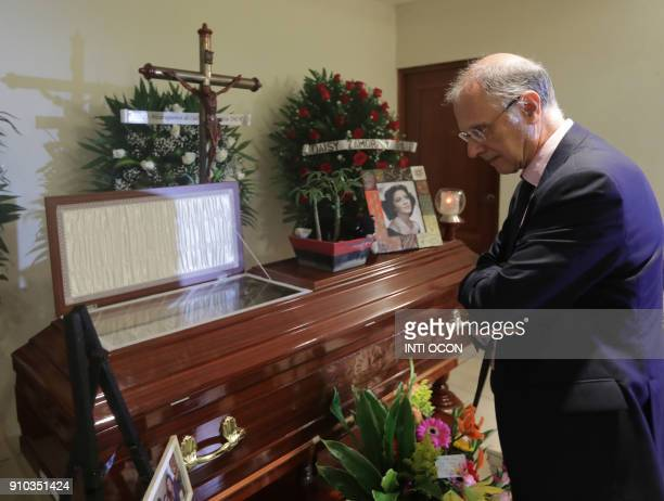 Spanish Ambassador Rafael Garranzo pays his respects next to the coffin of Nicaraguan poet Claribel Alegria at a funeral home in Managua on January...