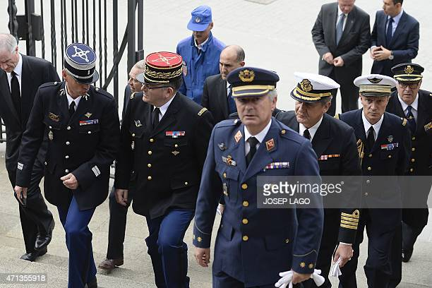 Spanish and French armed forces' representatives arrive at the Sagrada Familia's basilica in Barcelona on April 27, 2015 to attend a memorial service...