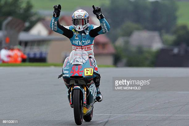 Spanish Aprilia driver Julian Simon celebrates after crossing the finish line to win the 125cc race during the German Grand Prix meeting on July 19...
