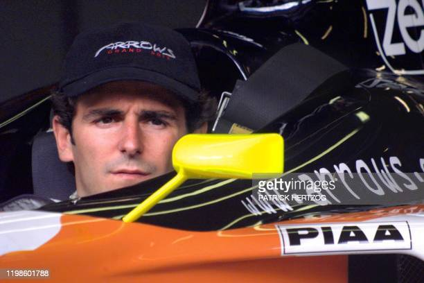 Spanish Arrows driver Pedro de la Rosa looks in his rear view mirror in the pits of the racetrack before the first free practice session in Spielberg...