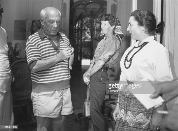 Spanish artist Pablo Picasso in his studio with his model Jacqueline Roque 1955 He and Jacqueline were married in 1961