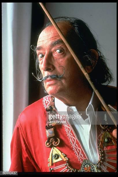 Spanish artist Salvador Dali near window