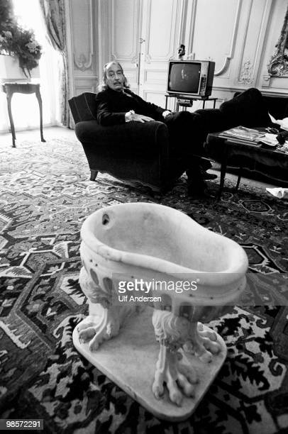 Spanish artist Salvador Dali poses in an armchair at the Le Meurice Hotel on October 241973 in ParisFrance