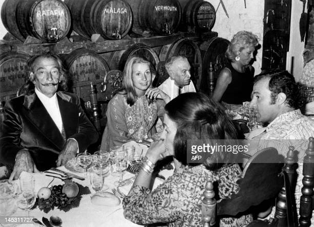 Spanish artist Salvador Dali sits in a restaurant of the Costa Brava on August 14 1972 with Maria del Carmen MartinezBordiu y Franco granddaughter of...