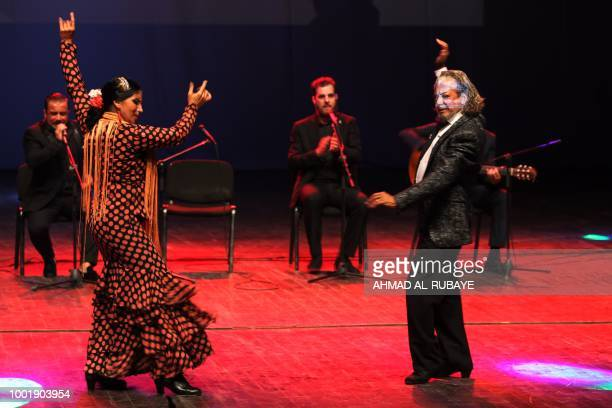 Spanish artists From the band 'El Embruio de Marbella' perform a Spanish flamengo dance at the national stage in Baghdad on July 19 2018 The concert...