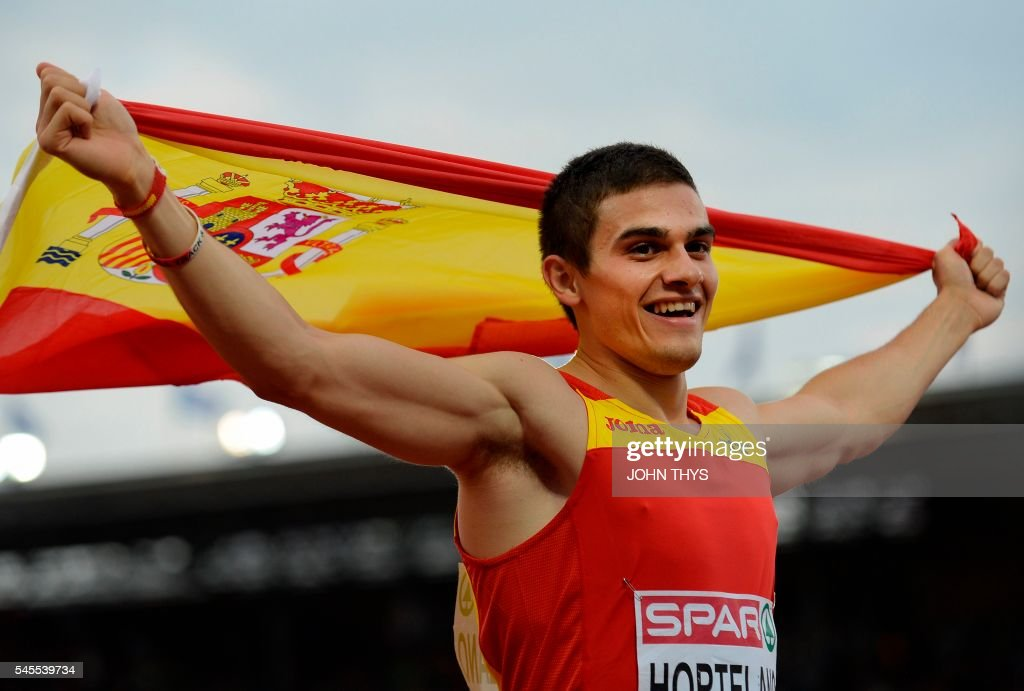 Spanish athlete Antonio Abadia celebrates after winning the men's 10,000 final race during the European Athletics Championships in Amsterdam at the Olympic Stadium on July 8, 2016. / AFP / JOHN