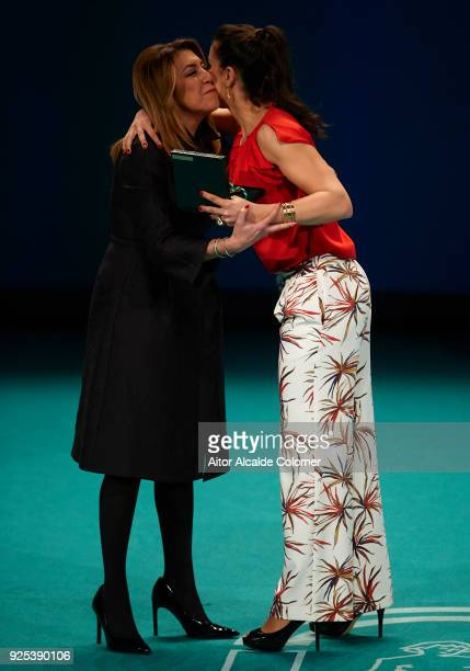 Spanish athlete Carolina Marin receives the medal from President of Andalusia Susana Diaz during the Medal of Andalucia awards 2018 at the Teatro la...