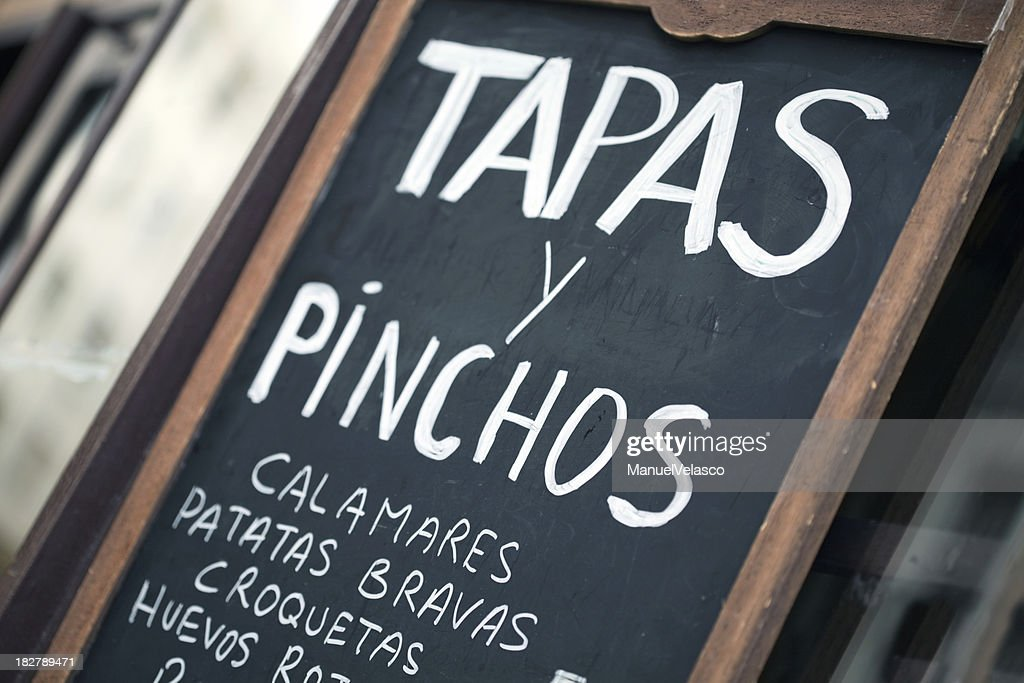 Spanish bar chalkboard featuring tapas y pinchos : Stock Photo