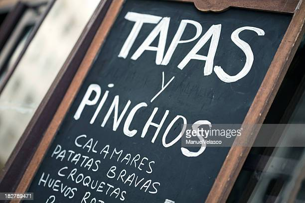 spanish bar chalkboard featuring tapas y pinchos - tapas stock photos and pictures
