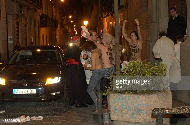 Spanish barebreasted activists of feminist movement Femen react upon the arrival of Spanish cardinal and archbishop of Madrid Antonio Maria Rouco...