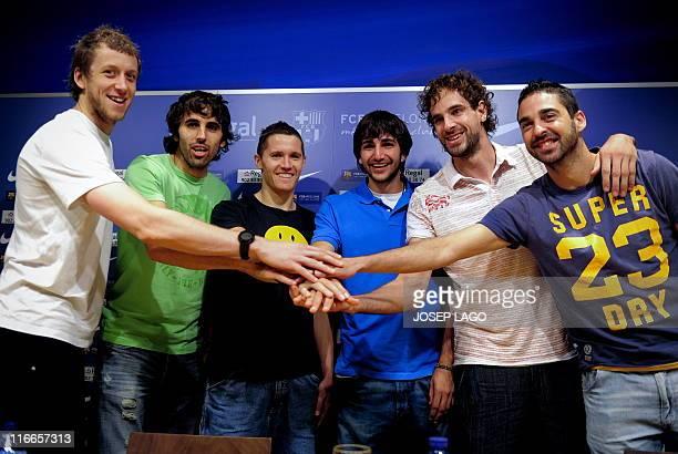 Spanish basketball player Ricky Rubio shakes hands with his teammates Joe Ingles Victor Sada Jaka Lakovic Roger Grimau and Juan Carlos Navarro after...