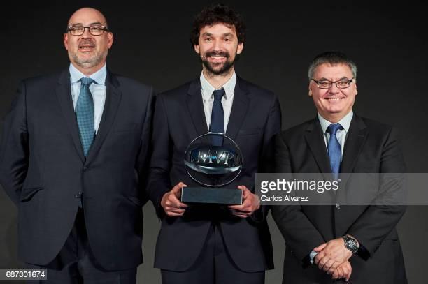 Spanish basketball player Sergio Llull of Real Madrid receives the 'MVP Movistar de la Liga Endesa 2016-2017' award from Telefonica Director Emilio...
