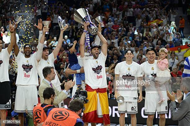 Spanish basketball team Real Madrid players celebrate after they have beaten their Greek opponents Olympiacos 78-59 in the final match at Barclaycard...