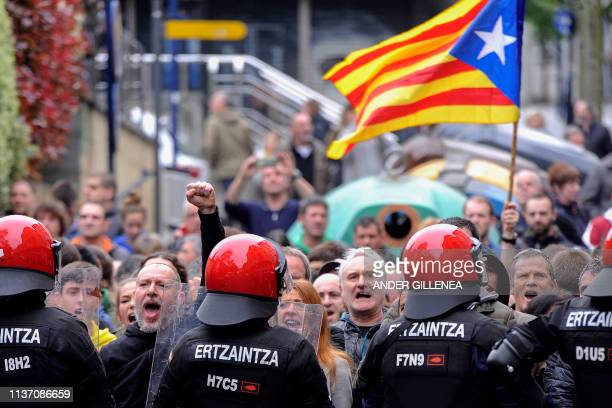 Spanish Basque police stand guard as protesters shout slogans against a campaign rally of Spanish centreright Ciudadanos party in the Spanish Basque...