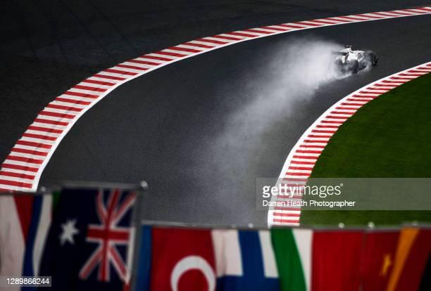 Spanish BMW Sauber-Ferrari Formula One racing driver Pedro de la Rosa driving his C29 racing car in wet rain conditions through the Raidillon Corner...