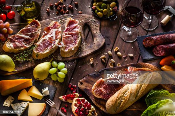 spanish bocadillo de jamon iberico, cheese and pickles - serrano ham stock photos and pictures