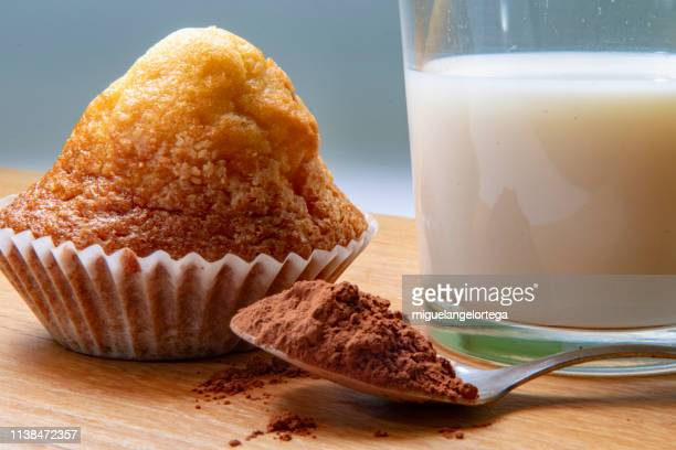 spanish breakast: milk, cocoa and muffin - marzipan stock pictures, royalty-free photos & images