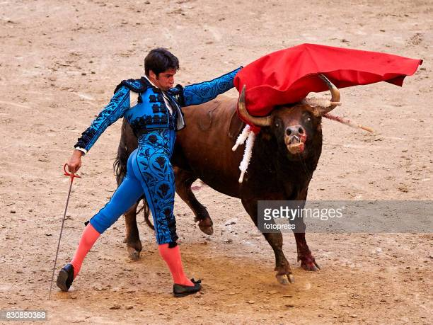Spanish bullfighter Cayetano Rivera Ordonez performs with a Maria Loreto Charro Santos ranch fighting bull during the bullfighting as part of the La...
