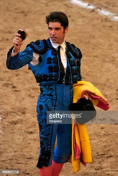 Spanish bullfighter Cayetano Rivera Ordonez shows the bull's ear after the bullfighting as part of the La Peregrina Festival at Plaza de Pontevedra...