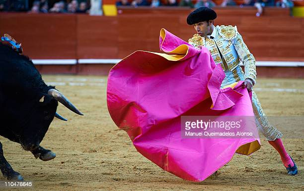 Spanish bullfighter Cayetano Rivera performs during a bullfight at the Plaza Valencia bullring on March 18 2011 in Valencia Spain